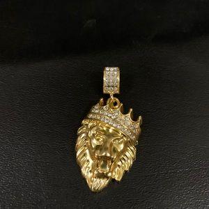 Lion pendant with rhinestones.